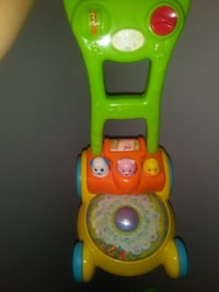 green and yellow Vtech learning walker LONGMONT