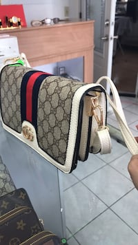 Gucci bag with strap,brand new  Calgary, T2B 3G1