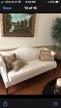 Elegant sofa off white fabric. Claw legs. Seats 3-4 people. Good buy!