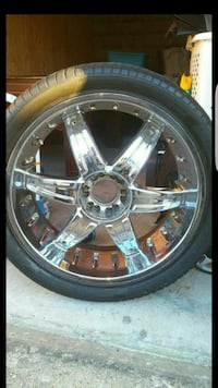 4 -24in chrome 6-spoke vehicle wheel with tire
