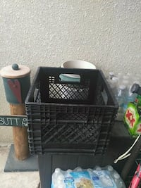 black metal pet cage and two black plastic contain