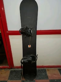 black and red snowboard with bindings 286 mi