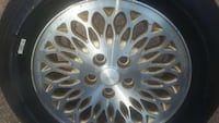 4 gold and metallic tear drop rims off of Chrysler Skipwith, 23968