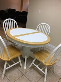 round white and brown wooden table with four chairs Brampton, L6Y 5J9