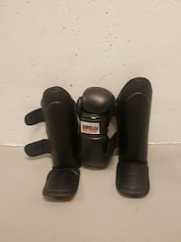 pair of black leather shin guards