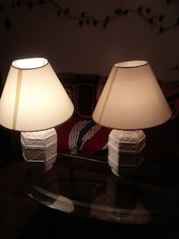 two white table lamps with white lampshades null