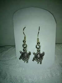 pair of silver-colored turtle earrings Inverness