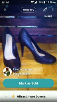 pair of women's black leather pumps screenshot Mississauga, L4Z 1H7