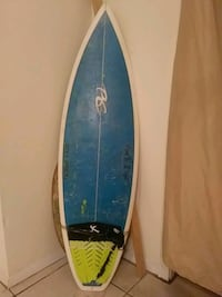 blue and white surfboard 762 mi