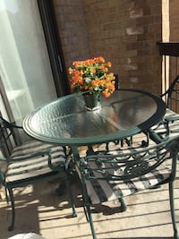 Wrought iron table with four chairs patio set Laval, H7T 1V5