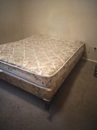 brown wooden bed frame with white mattress Fort Worth, 76132