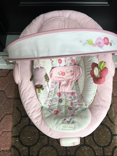 baby's white and pink bouncer seat