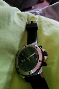 round silver-colored analog watch with black leath 23 mi