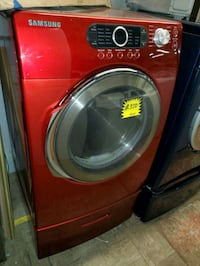 SAMSUNG electric dryer with pedestals working perfectly  Baltimore, 21223