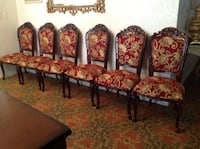 four brown wooden framed red and white floral padded chairs Houston, 77036