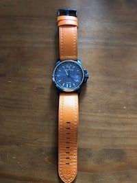 round silver-colored police analog watch with brown leather strap
