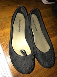 pair of black American Eagle leather flats SeaTac, 98198