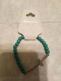 New Strechy turquoise with cross! Kearny