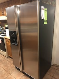 gray side-by-side refrigerator with dispenser 2348 mi