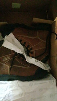 pair of brown leather work boots steel toe