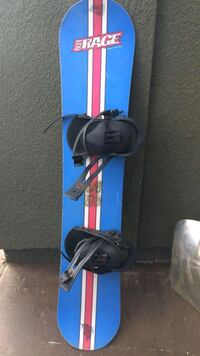blue and black snowboard with bindings 545 km