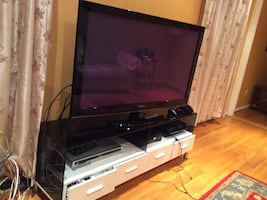 Flat screen 50 in working great all the new feature television and stand