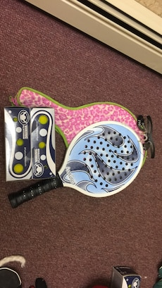 Paddle racquet and case with safety goggles and 2 boxes of unopened balls
