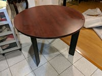 round brown wooden table with black metal base Markham, L3S 3B7
