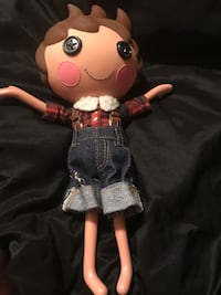 Brown, red, and blue doll wearing dress