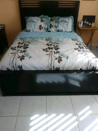 black wooden bed frame with white and black comfor Pompano Beach, 33065