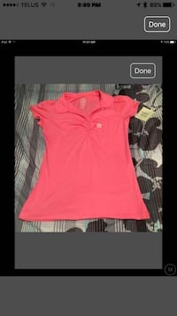 Female pink collar button shirt with tags.