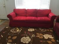 IKEA EKTORP SOFA,WITH RED SLIPCOVER, GREAT FOR EASY WASHING (PET AND SMOKE FREE HOUSE) Toronto, M1L 3Z3