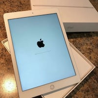 silver iPad with box and case Houston