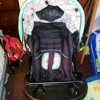 baby's black and green Graco stroller Dothan, 36301
