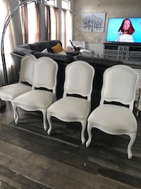 four white wooden framed gray padded chairs Middletown, 19709