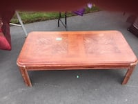 2ft by 4 ft low coffee table. It needs a little TLC but it a solid nice design table. Quinte West
