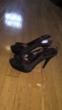 Size 7 black peep-toe sling-back pumps with bow on front