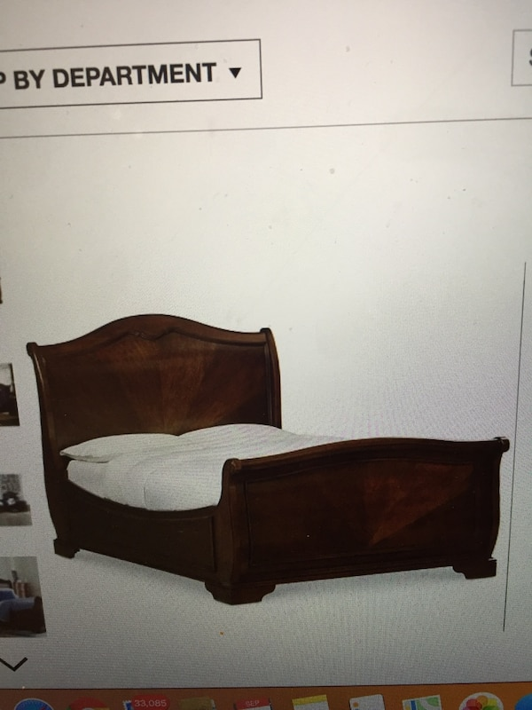 Brown wooden bed frame without white mattress