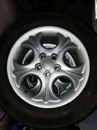 Toyota Corolla 2003. And up rims and 195-65-15 Mic Kitchener, N2R 1Y6