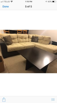 Skin and black sectional couch with table  Edmonton, T6X
