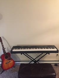 88 key beautiful electric piano by Williams Allegro with stand