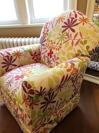 Rocking swivel chair custom upholstered in Jane Churchill fabric. Mint condition.  539 km