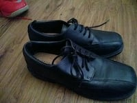 pair of black leather dress shoes Carrollton, 75006