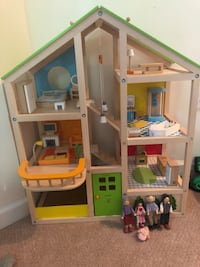 Wooden gender neutral playhouse with wooden dolls and furniture. Reversible roof for seasons 29 mi