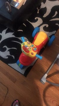 toddler's blue and red ride on toy 229 mi