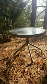 round black metal framed glass-top patio table Guntersville, 35976