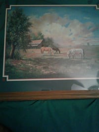 brown wooden framed painting of house 59 km