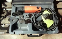 orange corded angle grinder with case