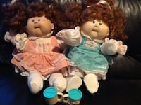 two Cabbage Patch Kids dolls