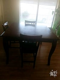 rectangular brown wooden table with four chairs dining set Peoria, 85345